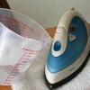 Чим і як очистити праска від накипу